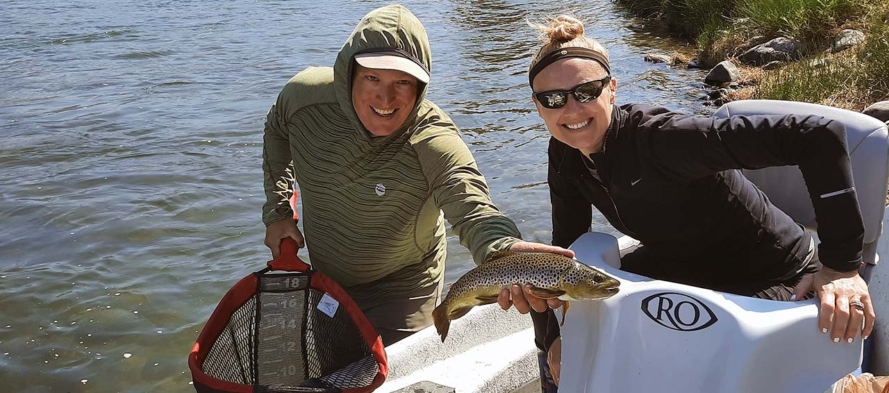 Yellowstone River fishing guide, client, and brown trout