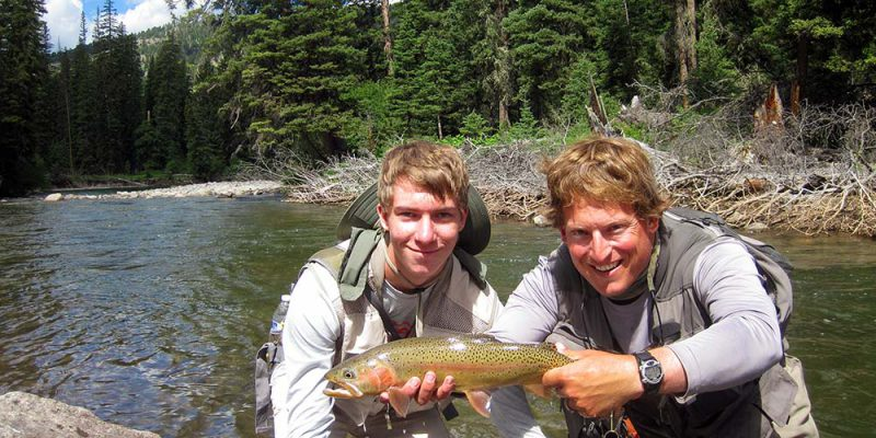 Angler and large rainbow-cutthroat hybrid in July