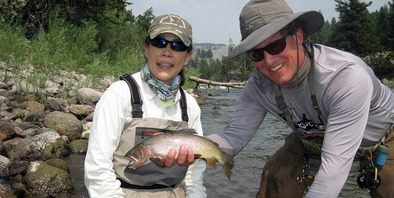Angler, guide, and cutthroat trout from an August Yellowstone fishing trip