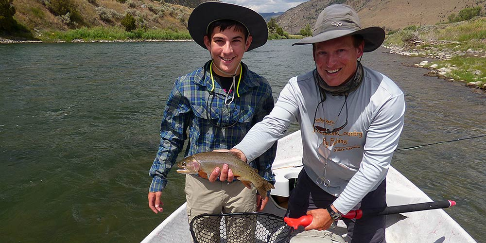 Angler with cutthroat trout on montana custom fly fishing trip