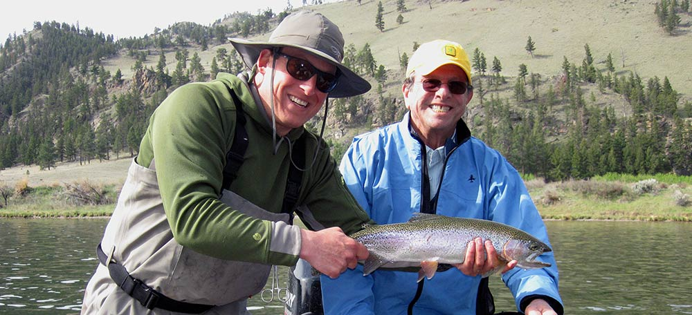 smiling angler and montana fishing guide on Montana jet boat fishing trip