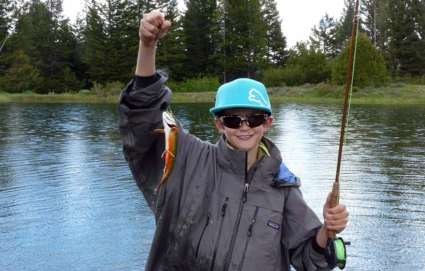 young angler and brook trout